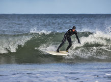 冲浪在Lossiemouth。 免版税库存图片