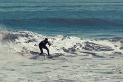 冲浪者在晴天 库存图片