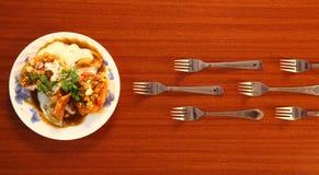冲用餐。 免版税库存图片