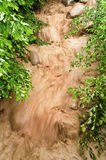 冲的泥泞的洪水 库存图片