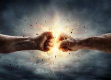 冲突概念-两拳头 图库摄影