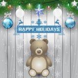 冷杉分支、玩具熊和圣诞灯电灯泡在木背景 免版税图库摄影