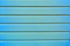 冷的冬天或海蓝色空的木背景设计 库存图片
