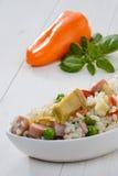 冷的米和橙色胡椒 免版税库存照片
