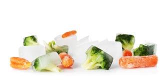 冻菜和冰块 免版税库存图片