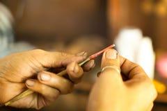 准备为传统纹身花刺竹子的工具 免版税库存图片