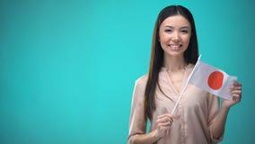 准备好微笑的夫人藏品日本的旗子学会外国语,日本学校 股票视频