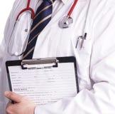 准备好男性的医生写耐心信息 库存图片
