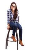 凉快的女孩坐椅子 图库摄影