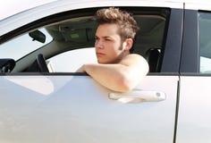 凉快的少年司机 免版税库存照片