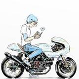 凉快的男孩骑马摩托车 免版税库存图片
