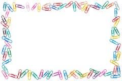 凌乱的纸夹五颜六色的框架在白色背景的 免版税库存照片