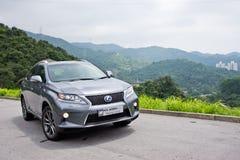 凌志RX 450h杂种SUV 2012年 免版税库存照片