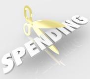 减少开支的剪刀减少价格费用 免版税库存照片