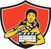 减速火箭亚洲妇女电影拍板的盾 免版税库存照片