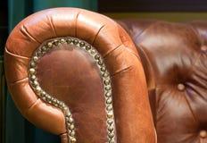 减速火箭古色古香的椅子的皮革 免版税库存图片