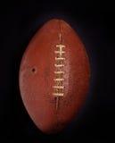 减速火箭古色古香的橄榄球的皮革 免版税库存照片