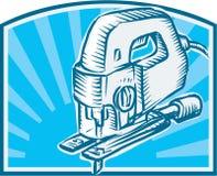 减速火箭曲线锯的电动工具的木刻 免版税库存照片