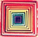 减速火箭的多色箱子的图片戏弄形式入几何方形的样式 免版税库存图片
