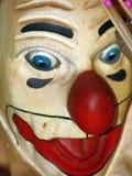 减速火箭的小丑头木头被绘的玩具 免版税库存照片