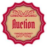 减速火箭的拍卖洋红色徽章 库存图片