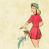 减速火箭的有自行车的背景少妇 免版税库存照片