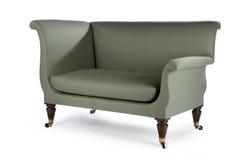 减速火箭的样式绿色沙发60,七十称呼老和古色古香 免版税库存照片