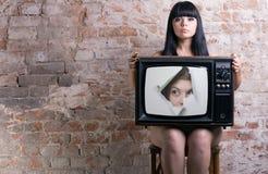 减速火箭的电视妇女 免版税库存图片