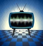 减速火箭的电视接收器在暗室 免版税库存照片