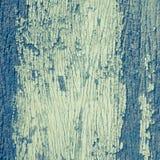 减速火箭的老被绘的破裂的削皮木头纹理 库存照片
