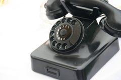 减速火箭的轮循拨号电话 免版税库存图片