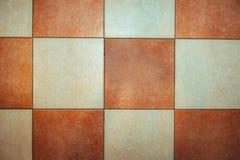 减速火箭的难看的东西棋枰背景纹理 使有大理石花纹的正方形 免版税库存照片