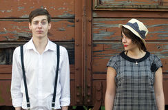 减速火箭的年轻爱夫妇葡萄酒滑稽的面孔工业设置 免版税图库摄影