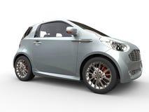 紧凑蓝灰色金属车的旁边特写镜头视图 免版税库存图片
