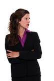 凝视的女实业家斜向一边 免版税库存图片