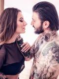 几乎亲吻在白色背景的年轻夫妇 库存图片