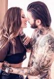 几乎亲吻性感的年轻的夫妇户内 图库摄影