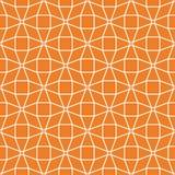 几何装饰品 橙色和白色无缝的样式 免版税库存照片