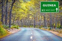 几内亚反对清楚的天空蔚蓝的路标 免版税库存图片