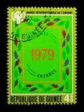几内亚显示数字1979年,儿童serie的年,大约1980年 免版税库存图片