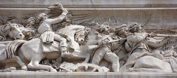 凯旋式的曲拱 在墙壁上有争斗 J争斗  库存图片