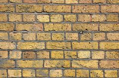 凹凸不平的砖墙纹理  免版税库存照片