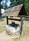 凹道喷泉井木头 库存照片