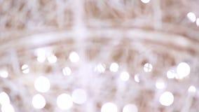 出于焦点背景,圣诞节照明设备 股票录像