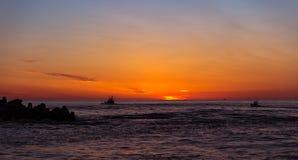 出去在日出的渔船 库存图片