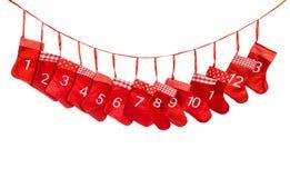 出现日历动画片圣诞节要素图标计时多种 圣诞节装饰红色长袜 图库摄影