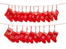出现日历1-24 红色圣诞节长袜礼物请求decoratio 库存图片