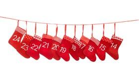 出现日历14-24 红色圣诞节长袜装饰 库存照片