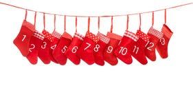 出现日历1-13 红色圣诞节长袜装饰 库存照片
