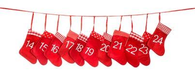 出现日历14-24 红色圣诞节长袜装饰 免版税库存照片